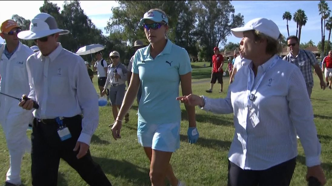 Lexi Thompson is told of her four-shot penalty by tournament officials