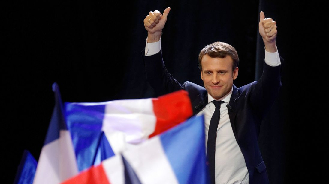 Emmanuel Macron celebrates topping the first round of the election