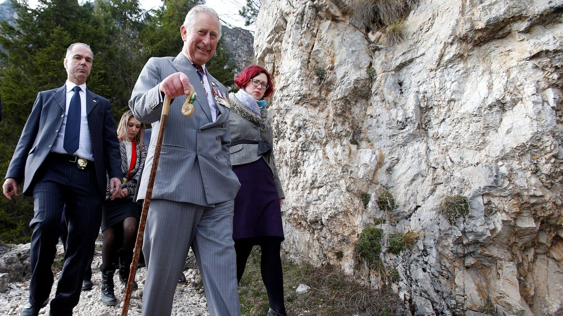 Prince Charles walks as he visits the Path of 52 Tunnels in the mountains created by the Italian military during the First World War at Bochetta di Campiglia near Vicenza