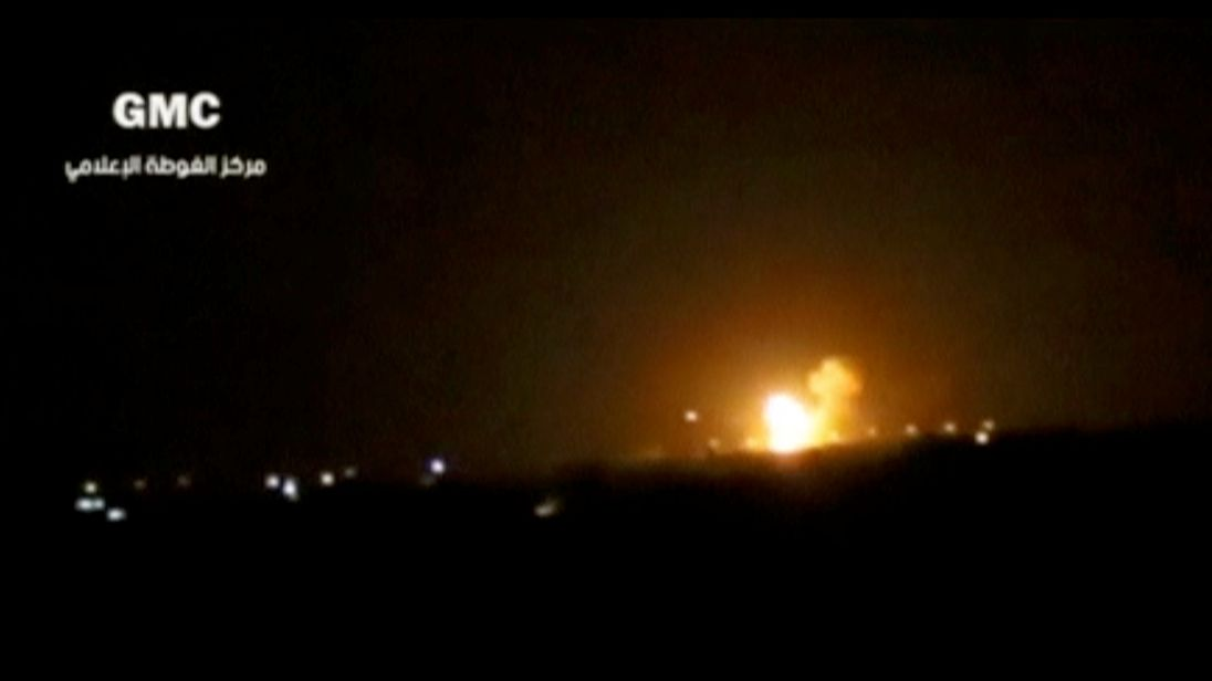 This image appears to show an explosion after a missile strike near an airport in Damascus