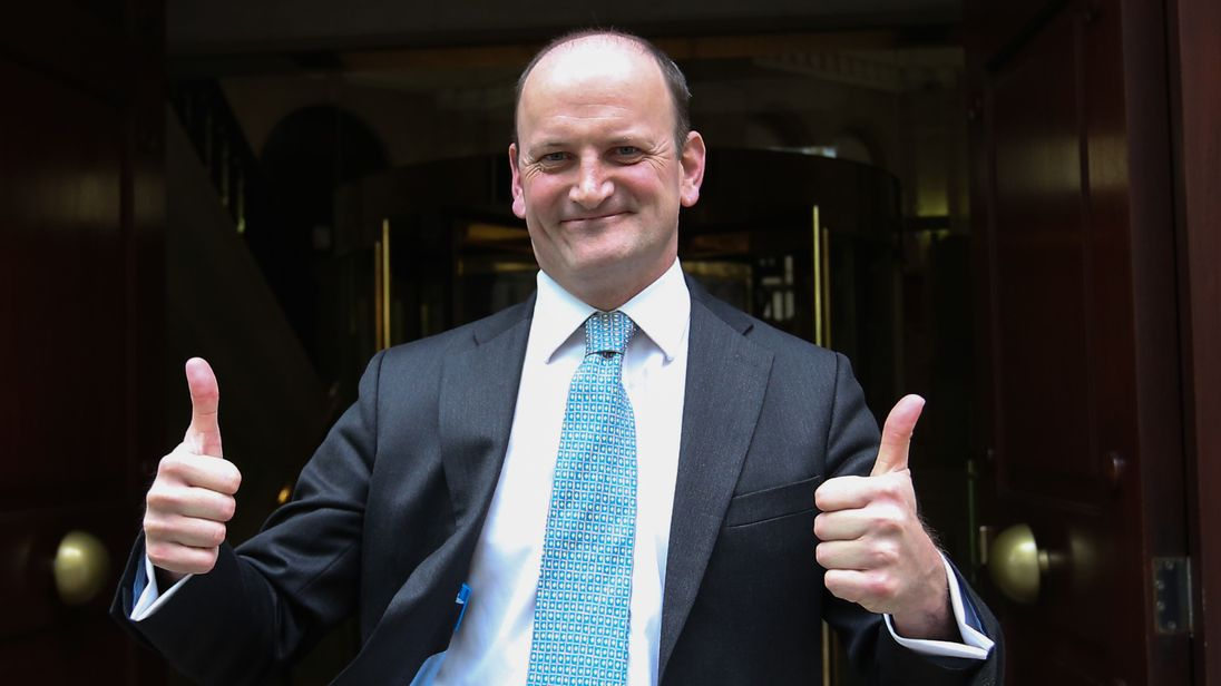 Douglas Carswell gives a thumbs up as he leaves Millbank tower after announcing that he will not be standing in the UK General Election
