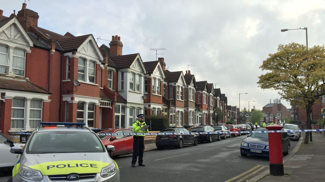 Police at the scene in Harlesden Road, Willesden