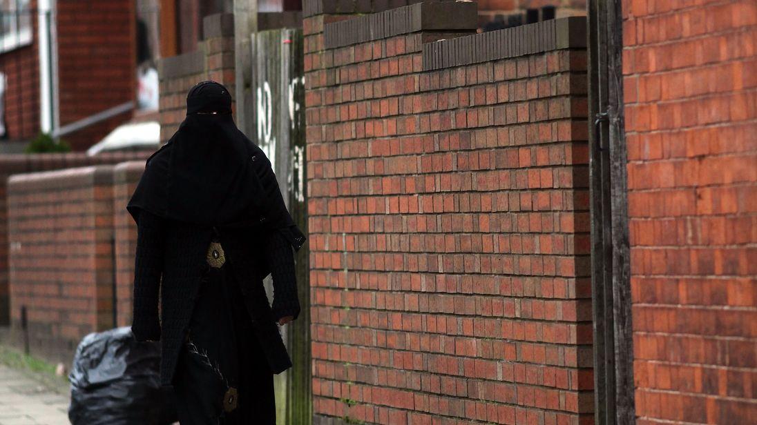 A Muslim woman wearing a traditional burka in Birmingham