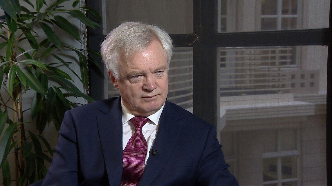 Brexit Secretary David Davis being interviewed in room.