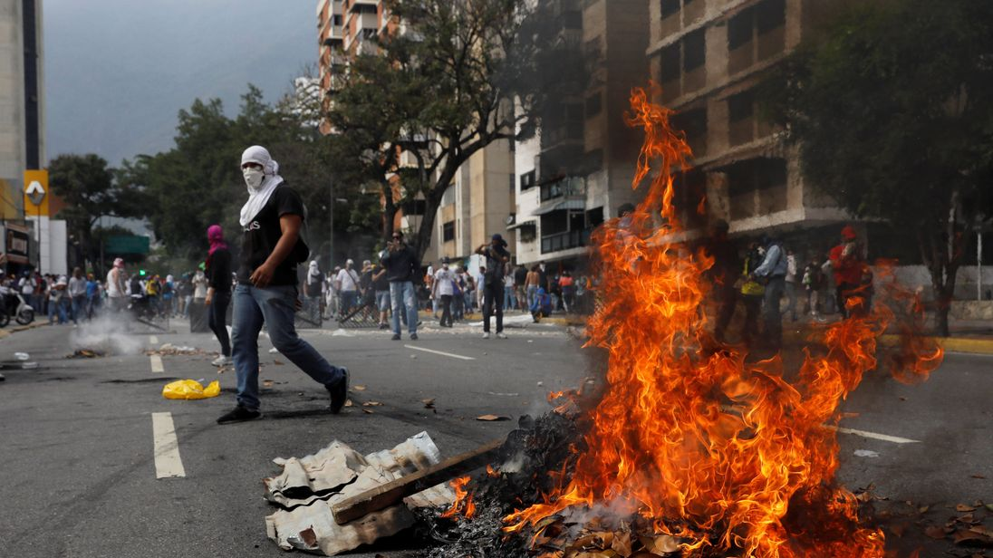 Opposition supporters clash with police during protests against unpopular leftist President Nicolas Maduro in Venezuela