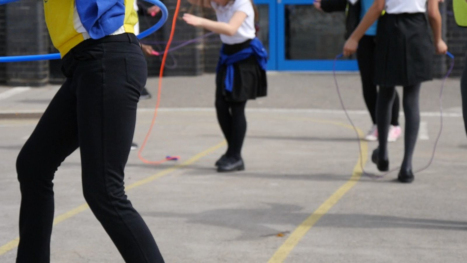 Anon school children playing in playground.
