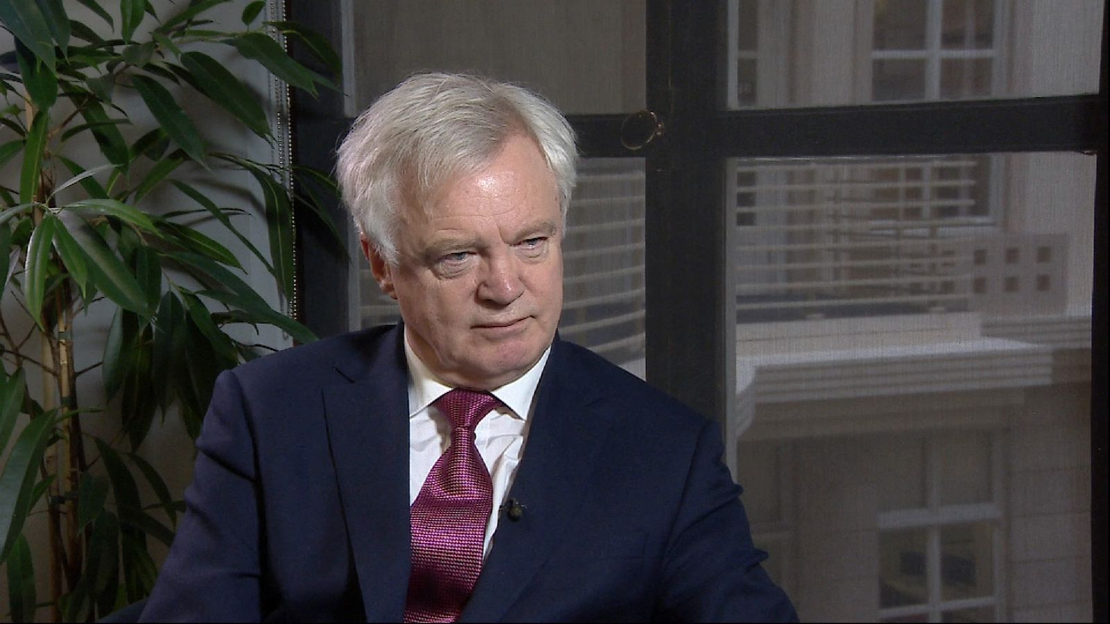 Brexit Secretary David Davis being interviewed in room.
