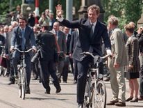 Tony Blair leads the pack as the EU leaders enjoy a short bike ride in Amsterdam, 1997