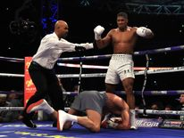 Wladamir Klitschko goes down against Anthony Joshua during the IBF, WBA and IBO Heavyweight World Title bout at Wembley Stadium