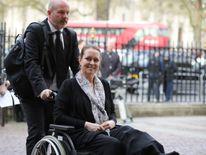 Melissa Cochran, the wife of victim Kurt Cochran, arrives at the service