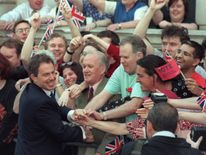 Britain's new Prime Minister Tony Blair is greeted by supporters outside 10 Downing Street, 02 May 1997