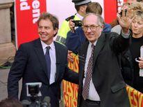 Tony Blair arrives with Scottish secretary Donald Dewar in Edingburgh