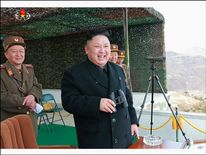 Kim Jong-Un laughs with his generals as the competition unfurls
