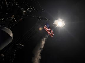 USS Porter launches cruise missiles while on operations in the Mediterreanean