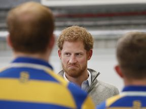 Prince Harry, Patron of the Invictus Games Foundation, speaks to members of Bath University Rugby team
