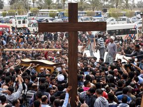 Mourners at the funeral of one of the victims of the blast at the Coptic Christian Saint Mark's church in Alexandria