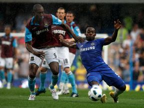 Michael Essien tackles Carlton Cole during a Premier League game in 2011