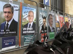 Defaced posters of the election candidates shows the apathy and division