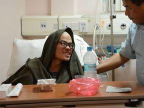 Mr Liang speaks to his doctor in hospital in Kathmandu
