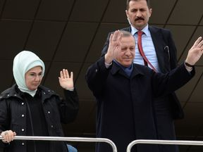 Recep Tayyip Erdogan and his wife Emine greet supporters at Ankara Esenboga Airport