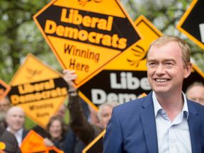 Tim Farron claims Labour 'is not behaving like an opposition'