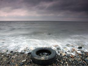 A tyre is left on a beach in Scotland