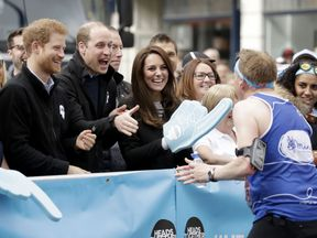 The Duke and Duchess of Cambridge and Prince Harry cheered on runners