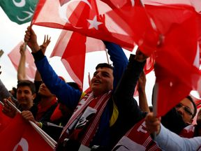 Supporters of President Erdogan wave national flags in Ankara