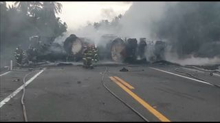 A bus and a tanker truck carrying gasoline crashed early on Thursday