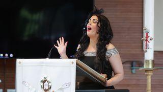 Professional dancer, TV presenter and talent show judge Róisín Mullins singing at the service