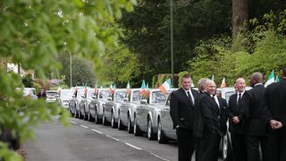 A fleet of Rolls Royce cars outside the church in Ashtead, Surrey