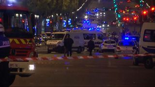 Emergency services respond after a policeman is shoot dead in Paris