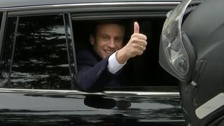 Emmanuel Macron, head of the political movement En Marche !, or Onwards !, and candidate for the 2017 French presidential election, waves from his car as he leaves his home before voting in the first round of 2017 French presidential election in Le Touquet, northern France, April 23, 2017