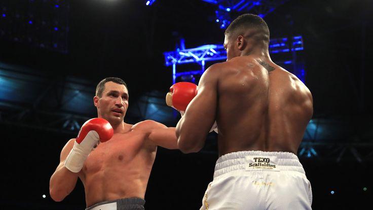 Anthony Joshua (White Shorts) and Wladimir Klitschko (Gray Shorts) in action during the IBF, WBA and IBO Heavyweight World Title bout at Wembley Stadium