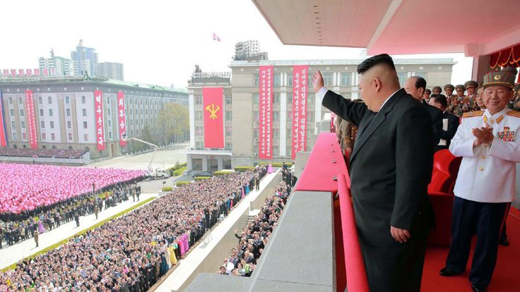 Kim Jong-Un waves to crowds following a military parade in Pyongyang