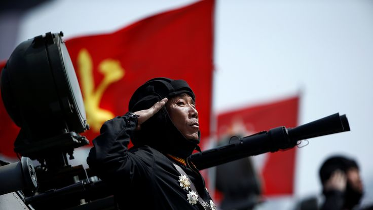 A soldier salutes North Korean leader Kim Jong Un