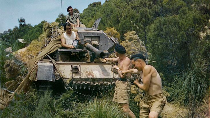A crew from the 16th/5th Lancers, 6th Armoured Division, cleaning the gun barrel of their Crusader tank at El Aroussa in Tunisia, May 1943