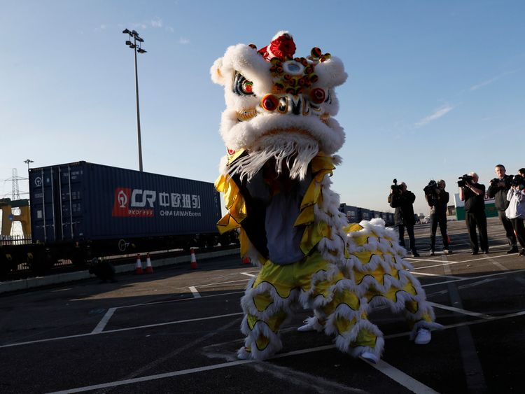 Performers dance during a welcoming ceremony to mark the inaugural trip for the first freight train to travel from China to Britain at at Barking Intermodal Terminal near London 18 January 2017