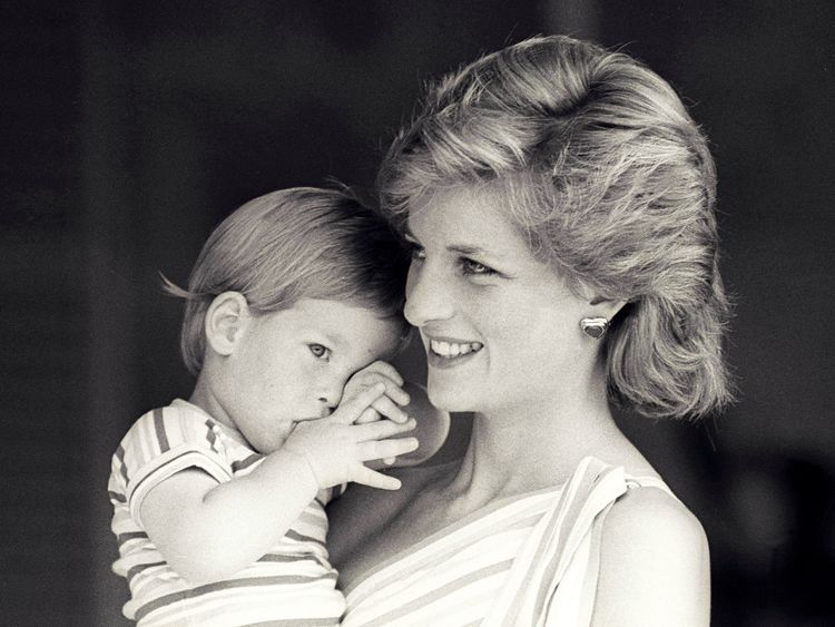 A picture of Diana holding Harry in Mallorca in 1988