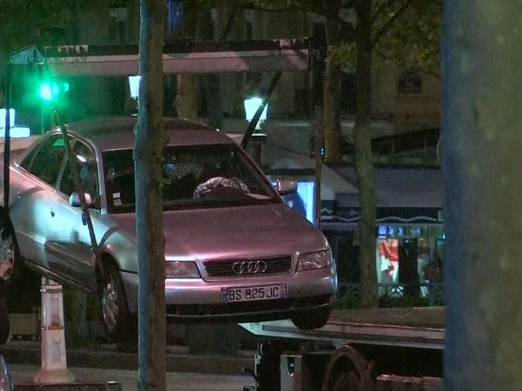The car believed to have been used in the attack is taken away for examination