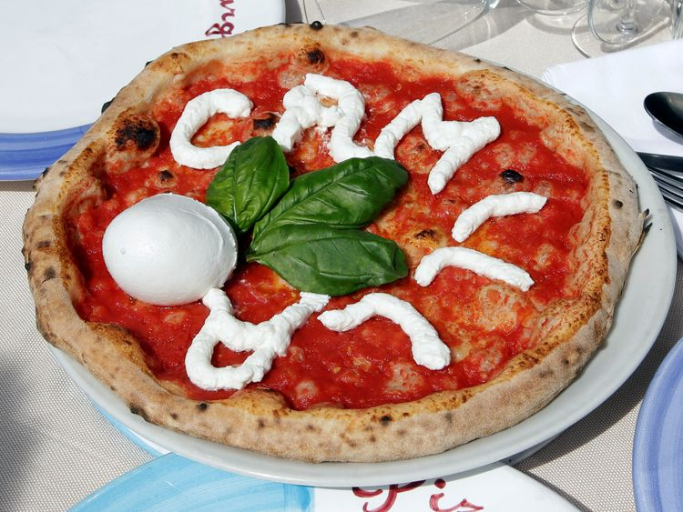 A pizzamaker honours the Duchess of Cornwall as she visits Naples