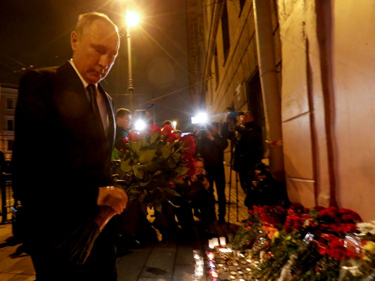 Vladimir Putin lays flowers outside Technology Institute station