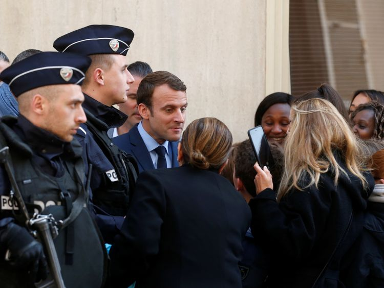 Emmanuel Macron was mobbed by supporters as he left his Paris home on Monday morning