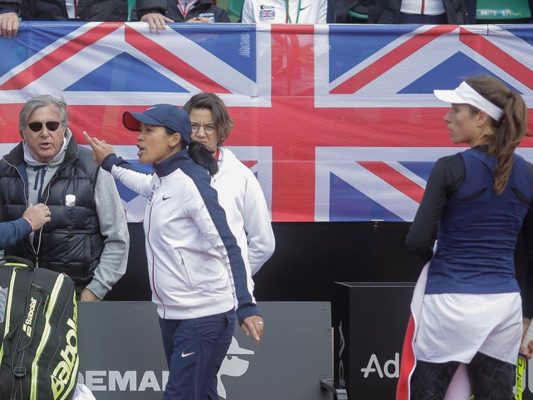 Great Britain's head coach Anne Keothavong gestures towards Romania's head coach Ilie Nastase during the FedCup Group II play-off match between Romania and Great Britain