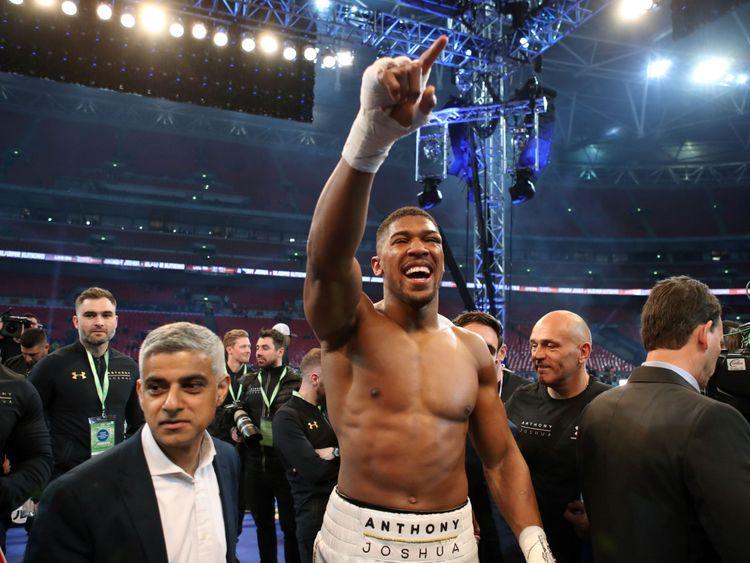 Anthony Joshua celebrates victory over Wladimir Klitschko following the IBF, WBA and IBO Heavyweight World Title bout with Mayor of London Sadiq Khan