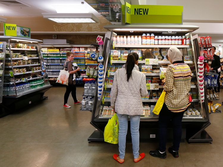 A customer shops in the food hall at a Marks & Spencer shop in central London May 21, 2013.