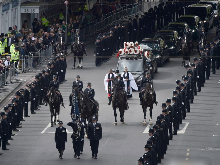 Police officers line the streets as PC Keith Palmer's coffin passes