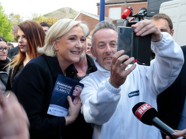Marine Le Pen and a voter take a selfie on the campaign trail in Rouvroy