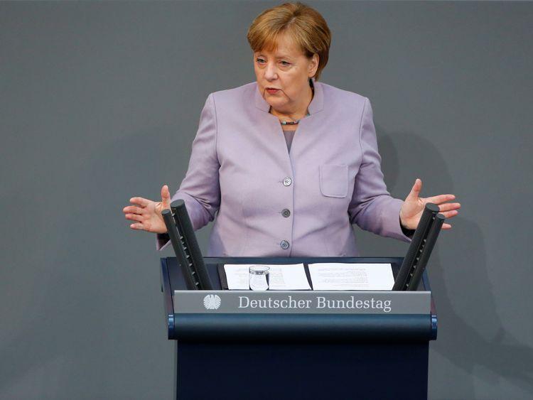 Angela Merkel addressing the lower house of Germany's Parliament on Thursday