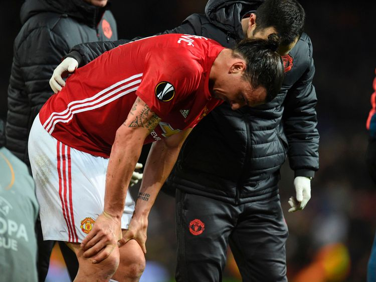 Zlatan Ibrahimovic is escorted from the pitch after getting injured against Anderlecht